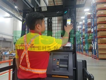 DHL Singapore -Employee completing a safety and fatigue checklist at the beginning of a shift.